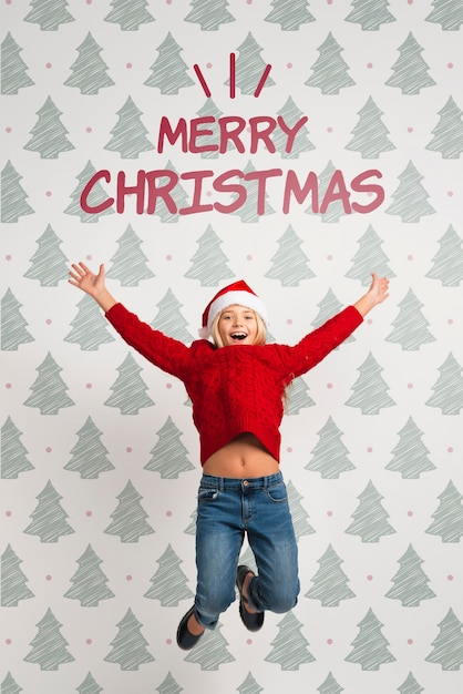 Девушка, одетая в красное для рождественских прыжков Бесплатные Psd