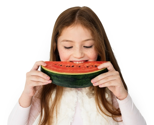 Girl eating watermelon studio concept Free Psd