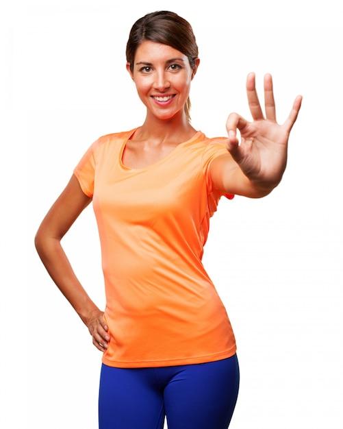 Girl in sportswear showing positive gesture Free Psd