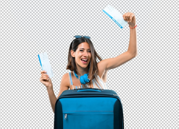 Girl traveling with her suitcase holding air tickets Premium Psd