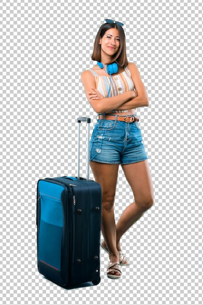 Girl traveling with her suitcase keeping the arms crossed in frontal position. confident expression Premium Psd