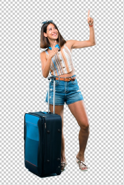 Girl traveling with her suitcase pointing with the index finger a great idea and looking up Premium Psd