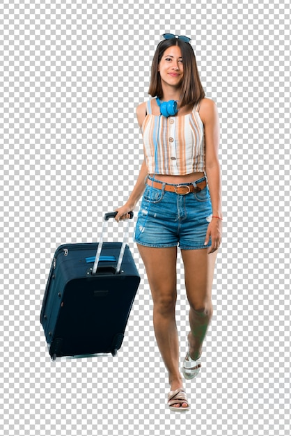 Girl traveling with her suitcase walking. motion gesture. Premium Psd