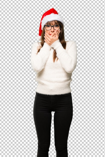 Girl with celebrating the christmas holidays covering mouth for saying something inappropr Premium Psd