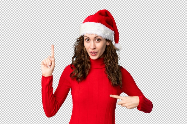 Girl with christmas hat with surprise facial expression Premium Psd