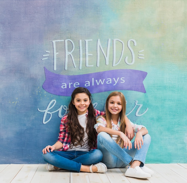 Girls in front of a wall with a quote mock-up Free Psd