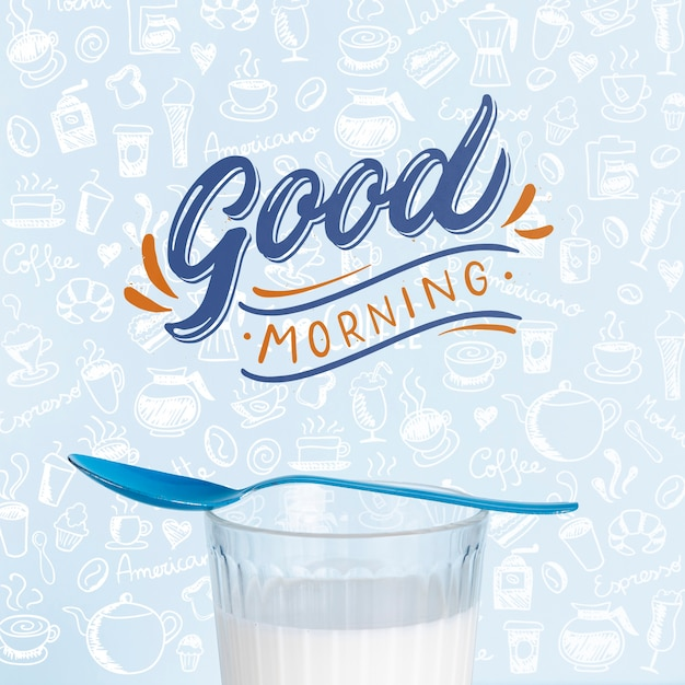 Glass of milk for breakfast on table Free Psd