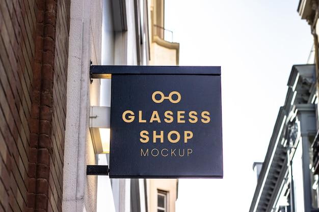 Glasses shop signboard mockup Free Psd