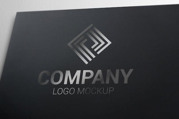 Glossy logo mockup on black paper. Premium Psd
