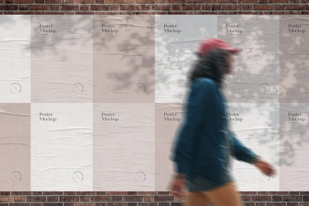 벽돌 벽 모형에 붙인 포스터 프리미엄 PSD 파일