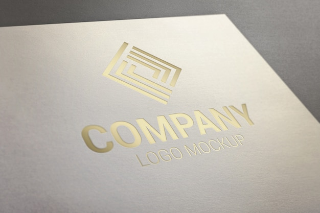 Gold glossy logo mockup on paper. Premium Psd