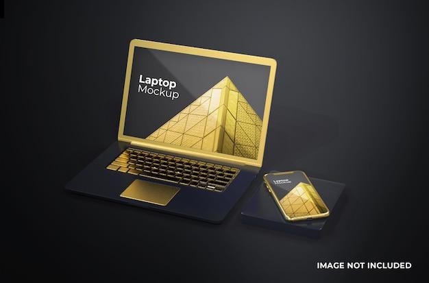 スマートフォンのモックアップを備えたゴールドのmacbook pro Premium Psd