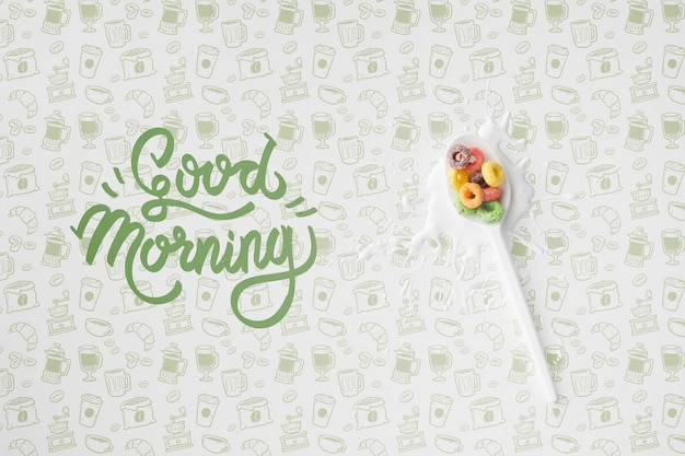 Good morning message beside spoon with cereals Free Psd