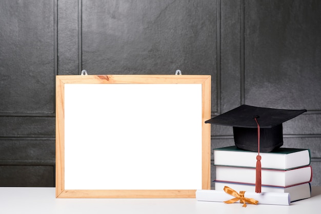 Graduation cap and book with frame mockupgraduation cap and book with frame mockup Premium Psd