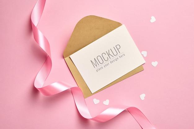 핑크 리본과 흰 종이 마음으로 인사말 카드 모형 프리미엄 PSD 파일