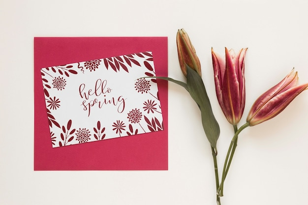 Greeting card with blooming flowers Free Psd