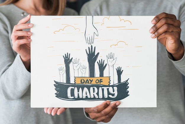 Group of people holding placard mockup for charity Free Psd