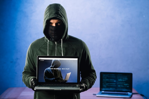 Hacker with laptop mockup Free Psd