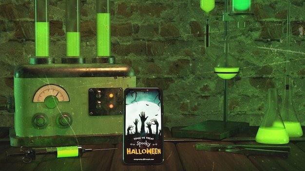 Halloween arrangement with smartphone and old machine Free Psd