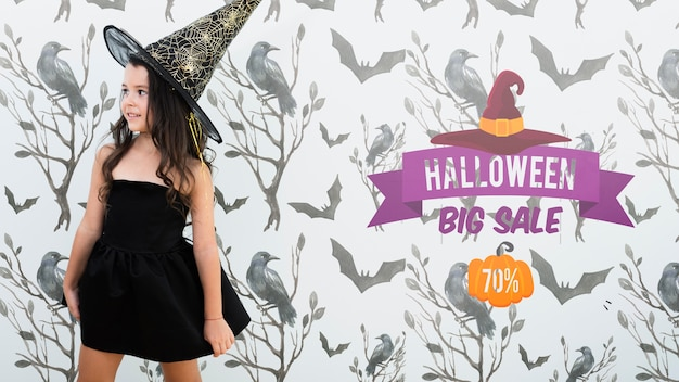 Halloween big sale and cute girl dressed as witch Free Psd