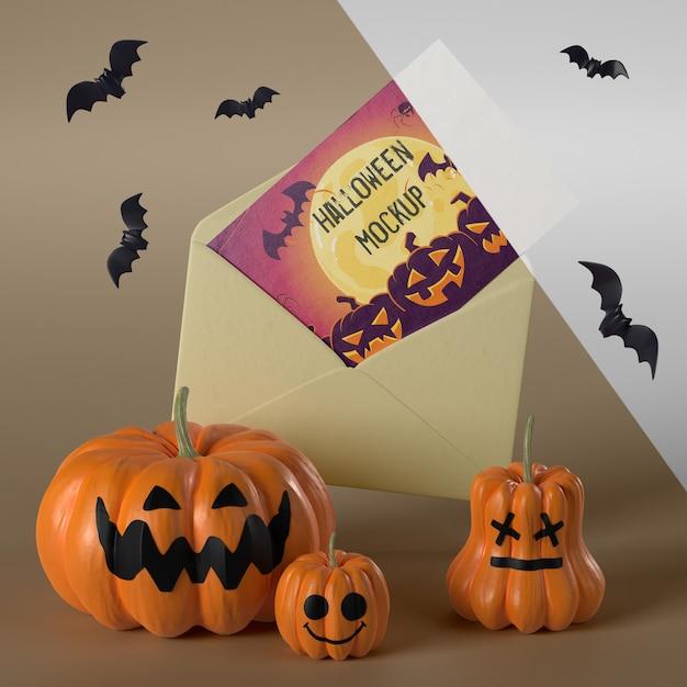 Mock-up di carta di halloween in busta gialla Psd Gratuite