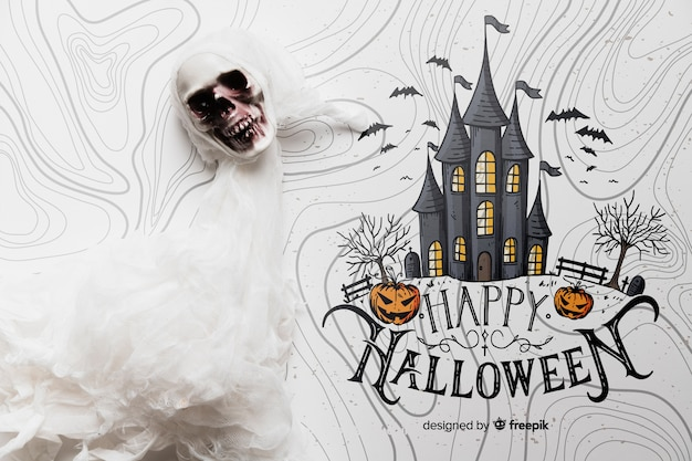 Halloween concept with skull and haunted house Free Psd
