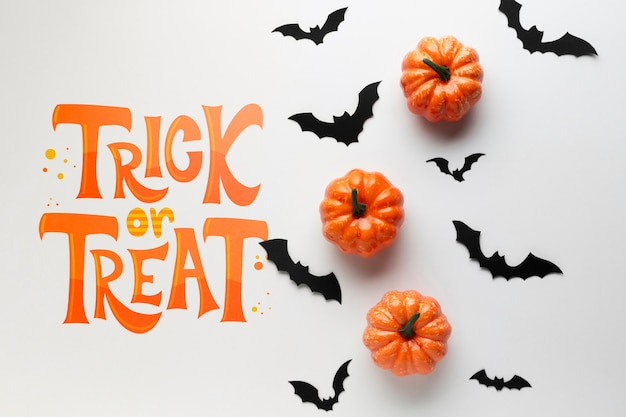Halloween day with bats and pumpkins Free Psd