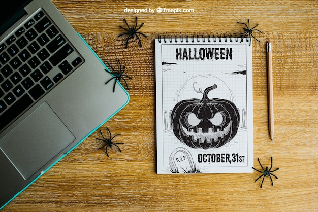 Halloween mockup with laptop and notepad Free Psd