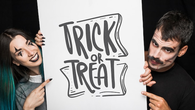 Halloween mockup with lettering on big board and couple Free Psd