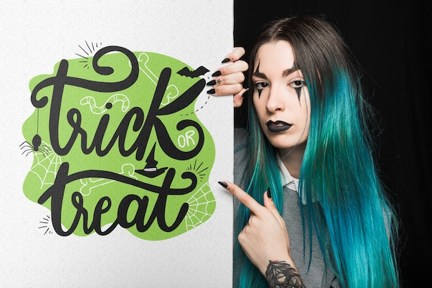 Halloween mockup with lettering on big board and woman Free Psd