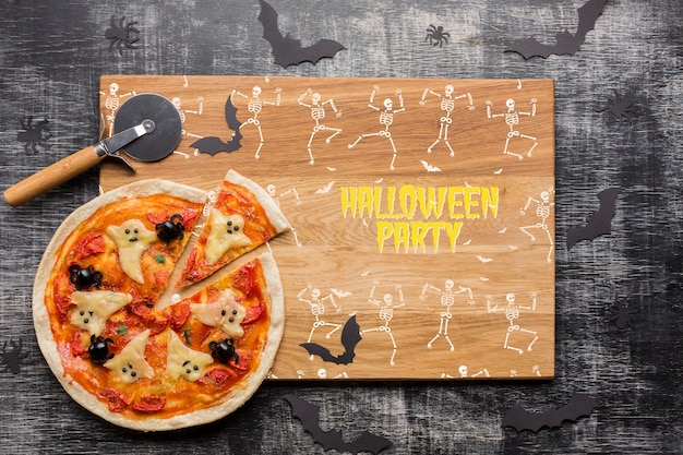 Halloween party with decorative pizza Free Psd