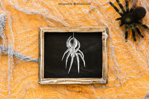 Halloween slate mockup on cobweb Free Psd