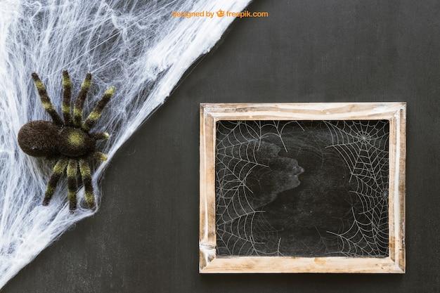 Halloween slate mockup with cobweb and spider Free Psd