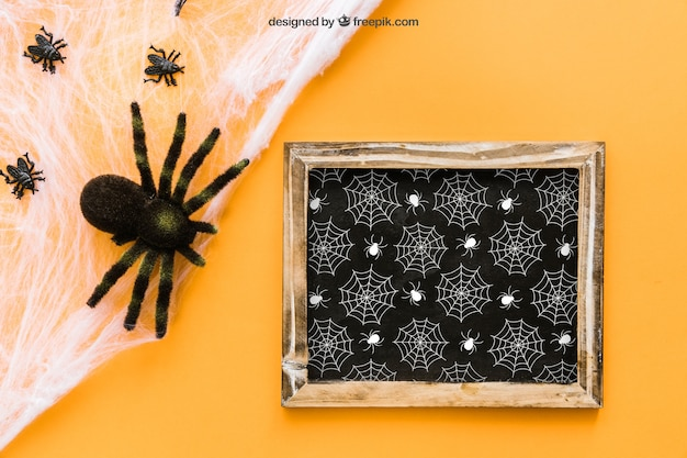 Halloween slate mockup with spiders Free Psd
