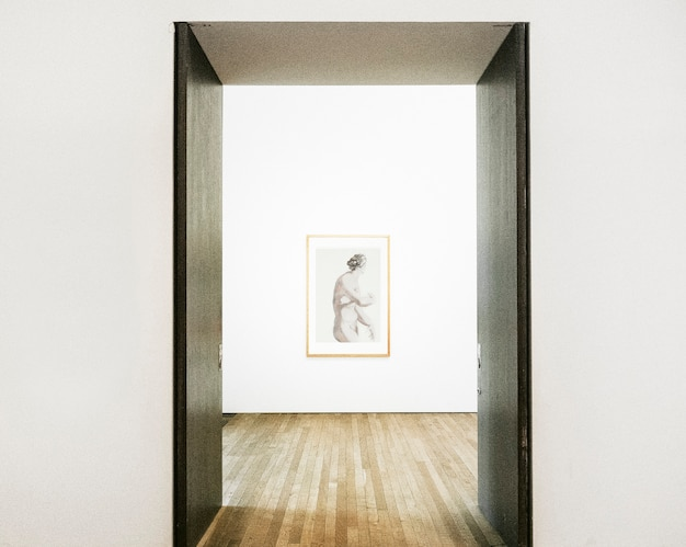 Hallway doors opening to framed art on a wall Free Psd