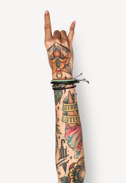 Hand doing punk gesture Premium Psd