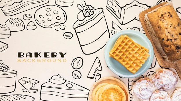Hand drawn bakery background with pancakes Free Psd