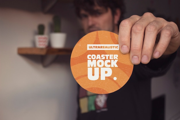 Hand front round coaster mockup Premium Psd