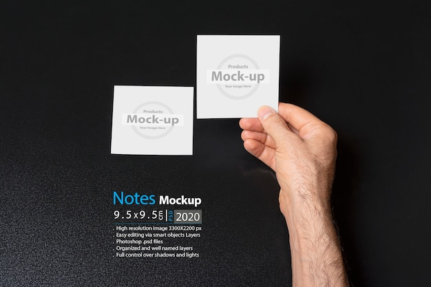 Hand holding a blank notes Premium Psd