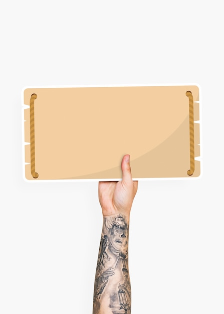 Hand holding a blank signage cardboard prop Premium Psd