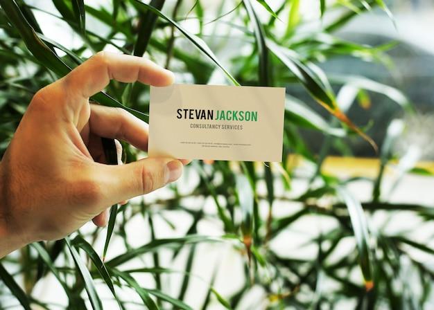 Hand holding business card mockup psd Premium Psd