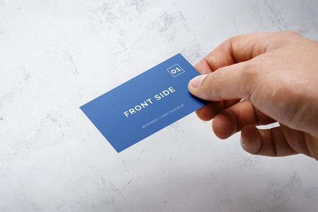 Hand holding business card mockup Premium Psd