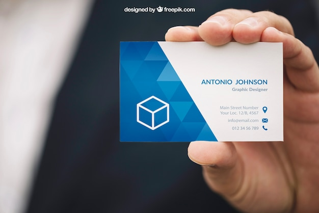 Hand holding business card mockup Free Psd