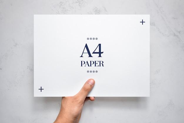 Hand holding flyer mockup Premium Psd