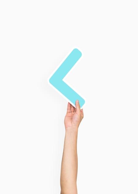 Hand holding a less-than sign Premium Psd