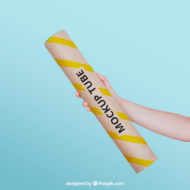Hand holding tube Free Psd