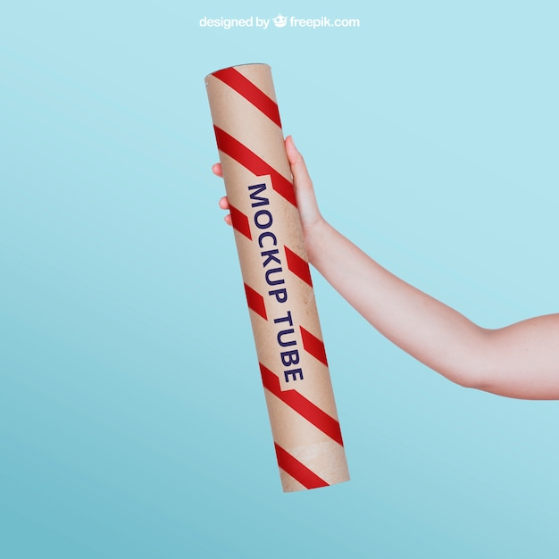 Hand holding a tube Free Psd