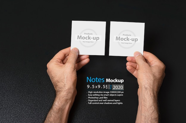 Hand holding two blank notes Premium Psd