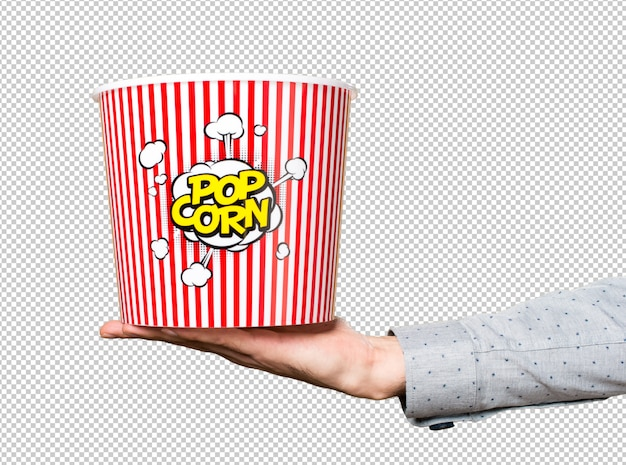 Hand of man holding popcorn box Premium Psd