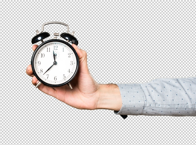 Hand of man holding vintage clock Premium Psd